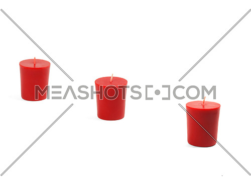 three red candles isolated on white background