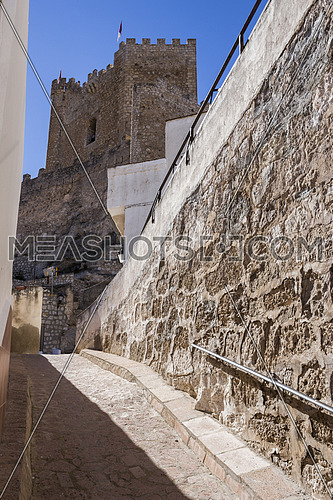 Alcala del Jucar, Spain - October 29, 2016: Side view of the village, on top of limestone mountain is situated Castle of the 12TH century Almohad origin, take in Alcala del Jucar, Albacete province, Spain