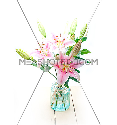 pink lily flower bunch  bouquet over white copyspace