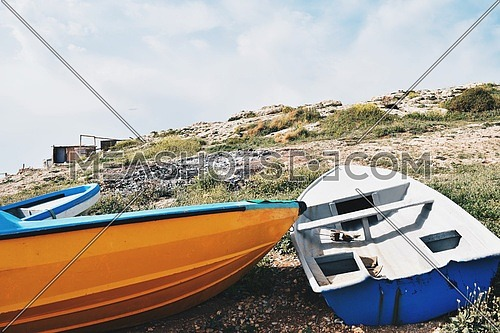 two boats parked on a rocky cliff Beirut, Lebanon