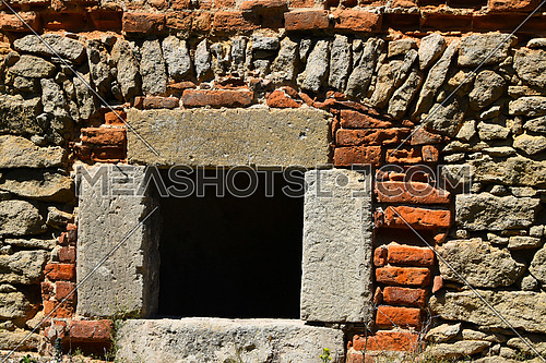 Dark black window in antique brick stone wall