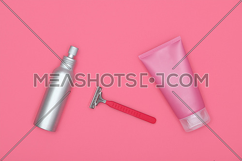 Feminine beauty care flat lay of shaving set on pink background, elevated top view, directly above