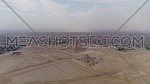 Aerial Shot for The Great Pyramids of Giza and two men Parachuting holding Egyptian Flag in Cairo by day
