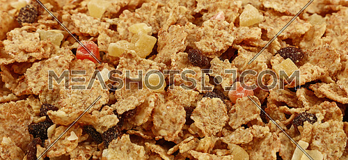 Breakfast granola muesli with dried fruits close up pattern background, low angle view, selective focus