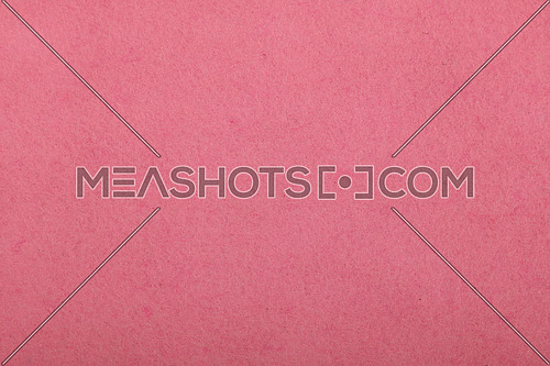 Pink felt textile material background texture close up