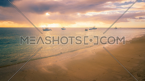 Fishing boats moored on the coast at sunset,glow effect.
