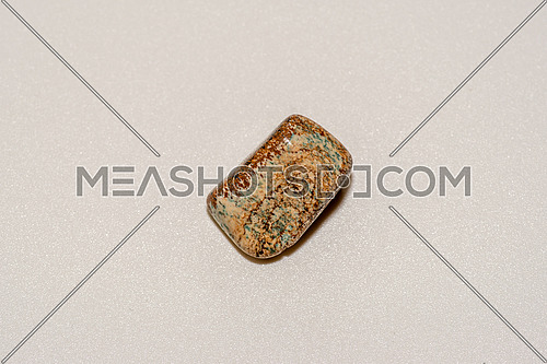 Tigers eye gemstone isolated on white background. Macro shot
