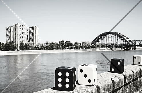 Large Poker Dices Moving In Stop Motion black and white