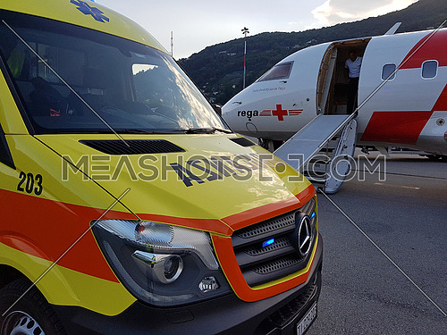Lugano, Ticino/Switzerland - May 26, 2016: REGA Canadair 640 air ambulance just arrived from Sardegna at Lugano airport for an emergency patient trans