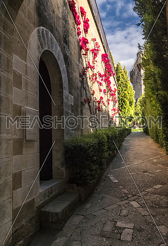 Almodovar del Rio, Cordoba, Spain - June 9, 2018: Gardens inside access to homage tower, It is a fortitude of Moslem origin, it was a Roman fort and the current building has definitely origin Berber, Almodovar del Rio, Spain