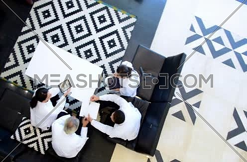 top shot - senior middle eastern doctors meeting and discussing with team