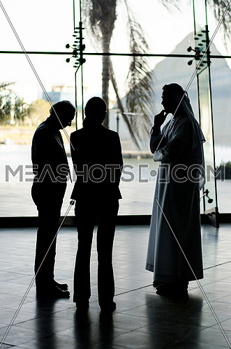 small group in a meeting with an Arab-man