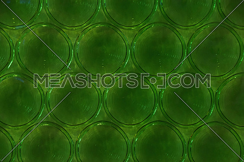 Bottle green stained glass window background round pattern with circles, close up