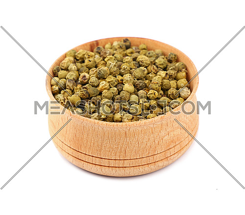 Close up one wooden bowl full of green pepper peppercorns isolated on white background, high angle view
