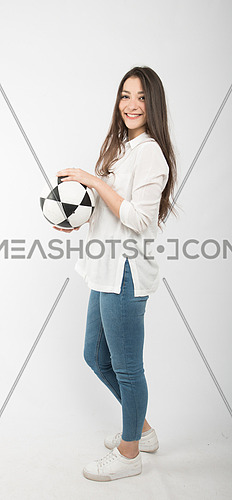 A young woman holding football world cup fan concept