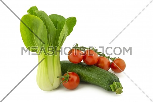 Chinese cabbage, green zucchini and cherry tomato twig isolated on white background