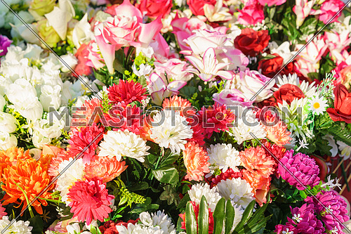 Various and beautiful colorful plastic flowers,decorative flowers, sold at the market