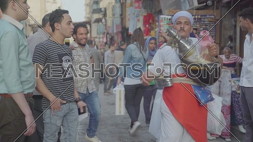 Fixed shot for Liquorice Juice seller in El Moez Street in Cairo at day
