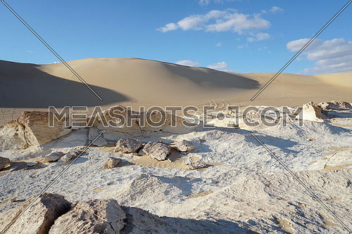 Fossil historical geographic desert  Rocks and bricks with sand dune background  , in Siwa Oasis, Egypt, Historicall , Adventure and Tourism Spot