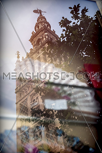 The Giralda of Seville reflected in a showcase, conceptual image