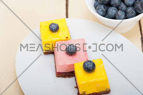fresh strawberry and mango mousse dessert cake with blueberry