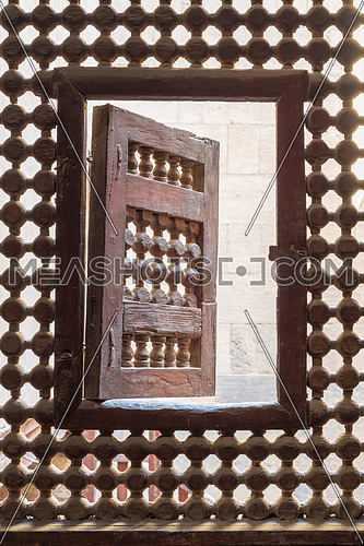 Wooden latticed window (Mashrabiya) with one small swinging sash, Cairo, Egypt