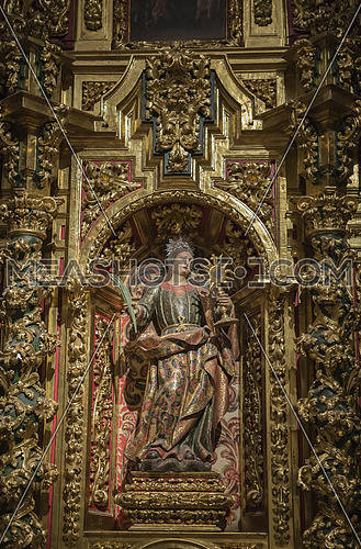 CUENCA, SPAIN - August 24, 2016: Interior of the Cathedral of Cuenca, St. Barbara's Chapel, situated behind the main Chapel and open to the ambulatory at the side of the Gospel, carved polychrome from the central niche of Santa Barbara, with its attributes of the Palm that carries in his right hand as a symbol of his martyrdom, and the monstrance in his left hand, Cuenca, heritage of humanity Spain