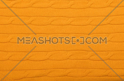 Close up background of vivid yellow knitted wool jersey fabric texture