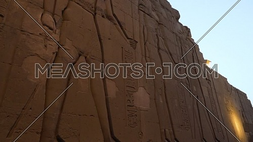 Tilt-up Shot for Writings on a wall at The Temple of Kom Ombo - Aswan, Egypt. by day